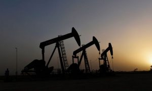 Oil rises as OPEC, allies work on big cut